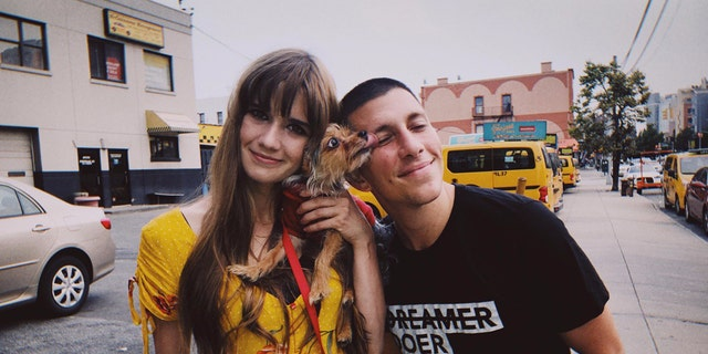 Lexi and Nick with Sarah's dog, Toto. They both now have jobs and are trying to get permanent housing.