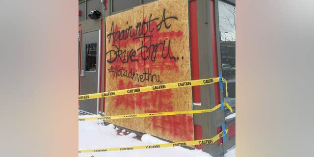 """Following the second accident in November, the staff spraypainted the phrase, """"Again, not a drive-thru"""" on the outside."""