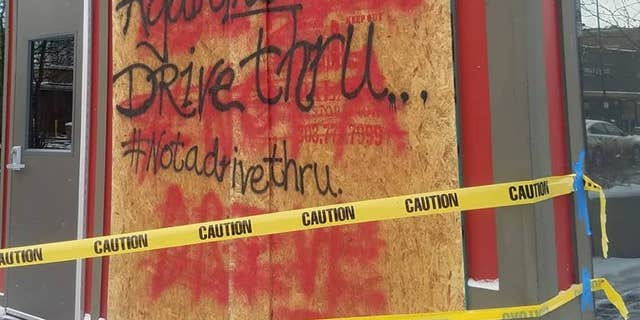 Following a second collision in November, a staff spraypainted a phrase, Again, not a drive-thru on a outside.