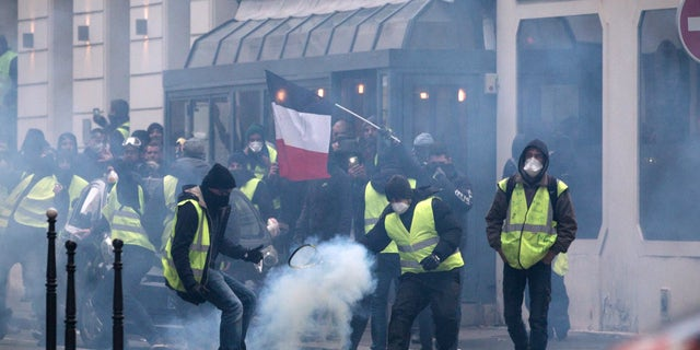 """Aurelien Morissard / Fox News; Clashes between police and demonstrators, during a demonstration of the """"Yellow vests"""", in Paris, France, on December 8th 2018."""