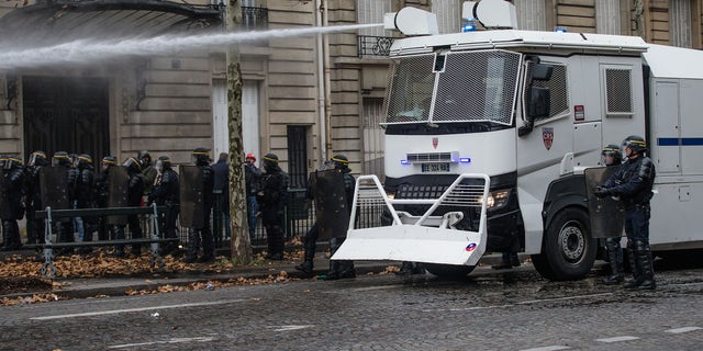 """Clashes between police and demonstrators, during demonstration of the """"Yellow vests"""", in Paris, France, on December 8th 2018."""