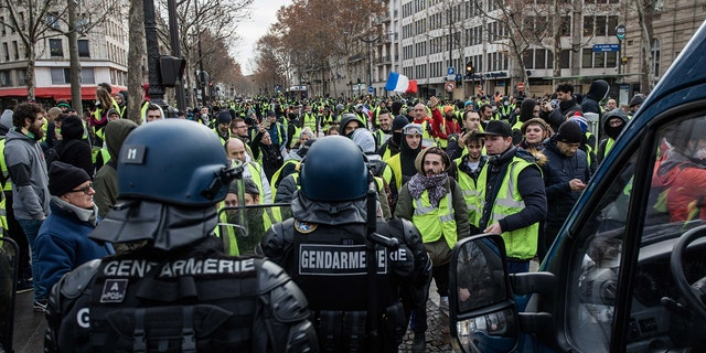 """Protester on the Rue Marceau, in front of the Place de l'Etoile, during demonstration of the """"Yellow Vests"""", in Paris, France, on December 8th 2018."""
