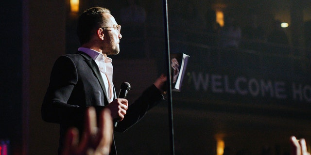 Carl Lentz, Hillsong Church NYC lead pastor, gave a special message to Darnell's father at the close of the service.