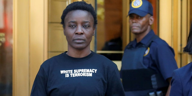 Patricia Okoumou walks out of federal court from her arraignment on July 5, a day after authorities say she scaled the stone pedestal of the Statue of Liberty to protest U.S. immigration policy.