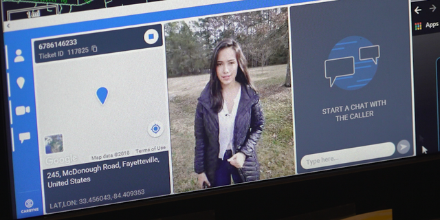 Fox's Emilie Ikeda tests out Fayette County's video 911 call, appearing on a call-taker's screen.