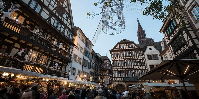 More than 1,000 people, according to reports, filled a square in the French city of Strasbourg on Sunday to show respect and sympathy for the victims of last week's shooting attack near a famous Christmas market as the death toll rose to five. (AP Photo/Jean-Francois Badias)