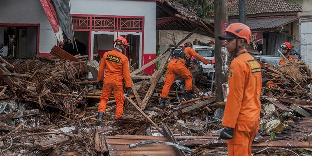 Rescuers search for tsunami victims in Carita, Indonesia, Sunday. (AP Photo/Fauzy Chaniago)