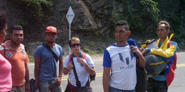Scores flee Venezuela on foot, often making dangerous treks through Colombia