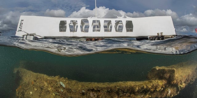 FILE:A view of the USS Arizona Memorial that also shows the ship's wreckage.