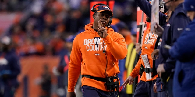 Denver Broncos head coach Vance Joseph, center, reacts on the sideline during the second half of an NFL football game against the Los Angeles Chargers, Sunday, Dec. 30, 2018, in Denver.