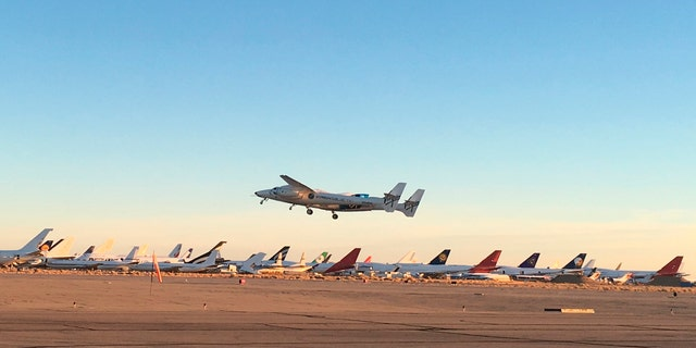 A jet carrying Virgin Galactic's tourism spaceship takes off from Mojave Air and Space Port on Thursday, Dec. 13, 2018 in Mojave, Calif. (AP Photo/John Antczak)