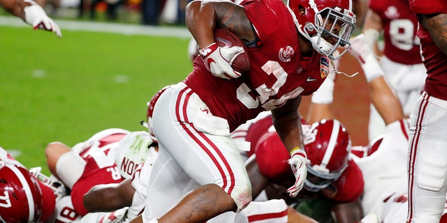 Alabama running back Damien Harris (34) scores a touchdown, during the first half of the Orange Bowl NCAA college football game against Oklahoma, Saturday, Dec. 29, 2018, in Miami Gardens, Fla. (Associated Press)