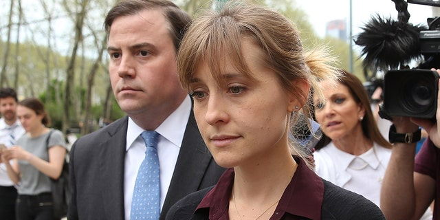Actress Allison Mack leaving court after a bail hearing in relation to the sex trafficking charges filed against her on May 4, 2018, in the Brooklyn borough of New York City.