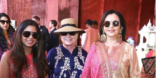 Hillary Clinton posing with bride Isha Ambani and mother-of-the-bride Nita Ambani. Huma Abedine is seen in the background.