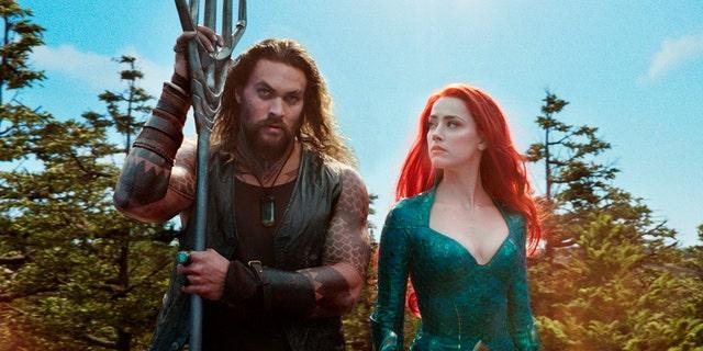 Jason Momoa as Arthur Curry/Aquaman and Amber Heard as Mera.