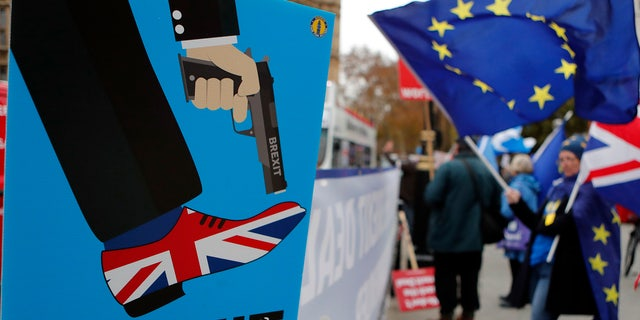 Protestors demonstrate opposite Parliament against Britain's Brexit split from Europe, in London, Thursday, Dec. 6, 2018.