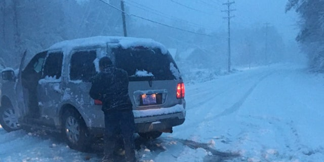 A motorist needed help after at least six inches of snow fell across parts of North Carolina on Sunday.