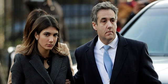 Michael Cohen, right, President Donald Trump's former lawyer, arrives at federal court for his sentencing for dodging taxes, lying to Congress and violating campaign finance laws in New York on Wednesday, Dec. 12, 2018. (AP Photo/Julio Cortez)