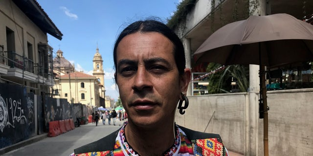 """""""I don't think there will ever be total peace, but many of these violent groups that have hurt this country so much have started demobilizing,"""" noted Juan, a 40-year-old artist and jewelry maker."""