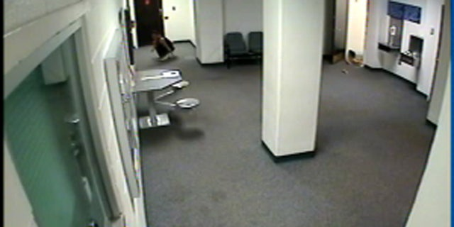Jessica Leger can be seen dropping from the ceiling into the lobby of the Jefferson County Jail.