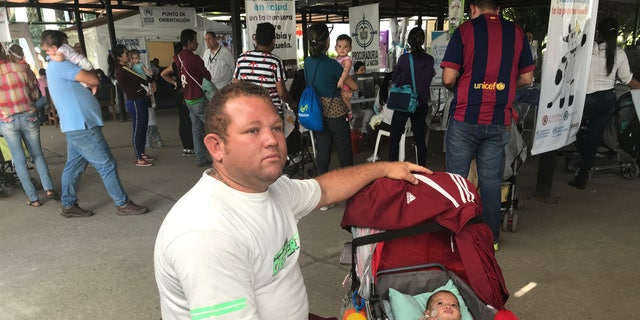 Alberto Camacho, 35 with his five-month-old daughter crosses from Venezuela to Colombia to find healthcare and vaccines.
