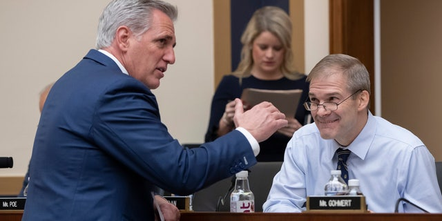 House Majority Leader Kevin McCarthy, R-Calif., left, talks with Rep. Jim Jordan, R-Ohio, before the House Judiciary Committee questions Google CEO Sundar Pichai about the internet giant's privacy security and data collection, on Capitol Hill in Washington, Tuesday, Dec. 11, 2018. (AP Photo/J. Scott Applewhite)