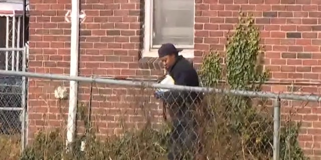 The shooting took place after the man forced three women leaving for church back into a home on Detroit's West Side. A crime scene investigator is seen walking outside the home.