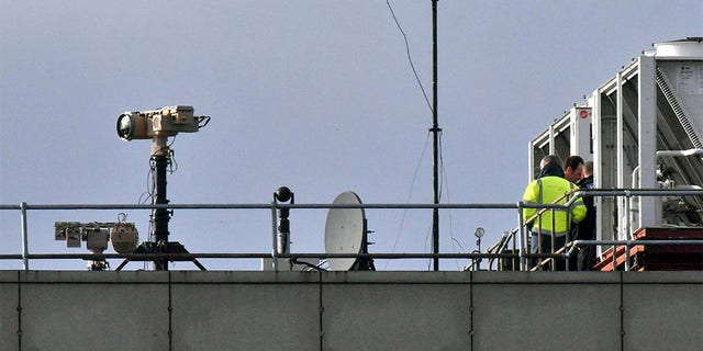Counter-drone equipment is deployed on a rooftop at Gatwick.