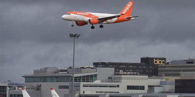 An EasyJet plane on its final approach before landing at Gatwick airport near London on Friday.