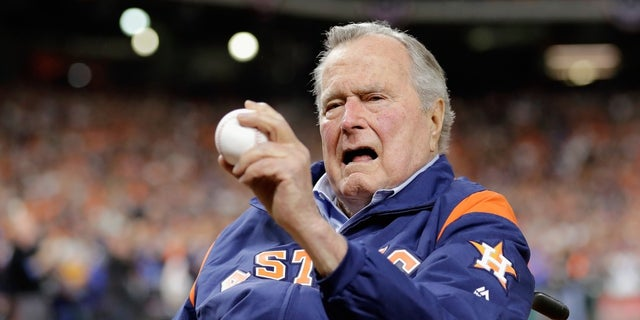 Former President George H.W. Bush threw out a ceremonial first pitch at Game 5 of the World Series between the Houston Astros and Los Angeles Dodgers.