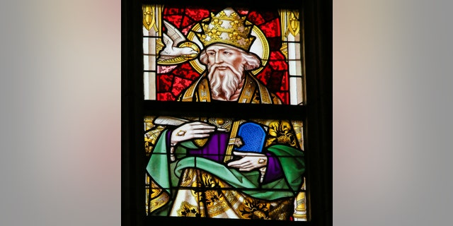 The Library of Congress says Pope Gregory, depicted here in a stained-glass portrait, declared that all who sneeze require a blessing.