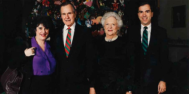 Janet Cawley and her brother Phil, far right, pictured with President George HW Bush and First Lady Barbara Bush at the White House Christmas party.