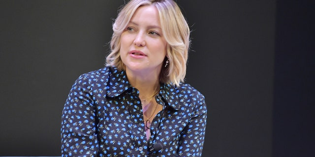 Kate Hudson speaks onstage during In Conversation with Michael Kors, Kate Hudson and The World Food Programme at UCLA on November 7, 2018 in Los Angeles, California.