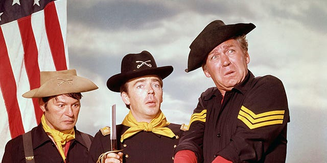 """The stars of """"F Troop,"""" from left: Larry Storch (Cpl. Agarn);Ken Berry (Capt. Parmenter); and Forrest Tucker (Sgt. O'Rourke). (ABC via Getty Images)"""