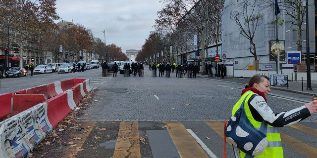 The scene in Paris early Saturday, Dec. 8, 2018, with the Arc de Triomphe far in the background. (Lukas Mikelionis/Fox News)