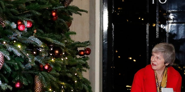 Britain's Prime Minister Theresa May, under fire for her handling of Brexit, attends the ceremony to light up a Christmas tree at 10 Downing Street in London, Thursday, Dec. 6, 2018. (AP Photo/Frank Augstein)