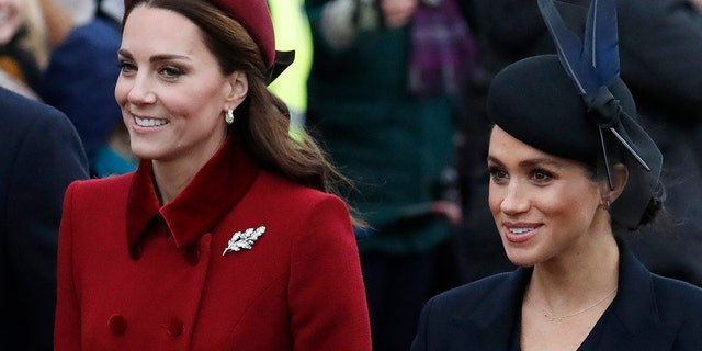 Britain's Kate, Duchess of Cambridge, left, and Meghan Duchess of Sussex, right, are all smiles before attending the Christmas day service at St Mary Magdalene Church in Sandringham in Norfolk, England, Tuesday, Dec. 25, 2018.