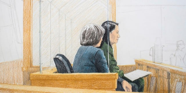 Meng Wanzhou, right, attends a bail hearing at British Columbia Supreme Court in Vancouver on Friday, Dec. 7, 2018.