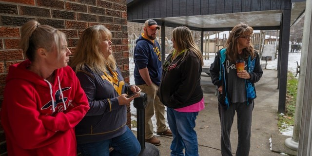 Family and friends await word of the search teams' efforts in finding Cody Beverly, Kayla Williams and Erica Treadway at the Salamy Memorial Center in Whitesville, W.Va., on Wednesday, December 12, 2018.