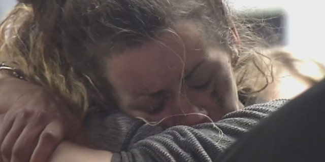 Kayla Williams embraces a loved one after being rescued from the mine on Wednesday.