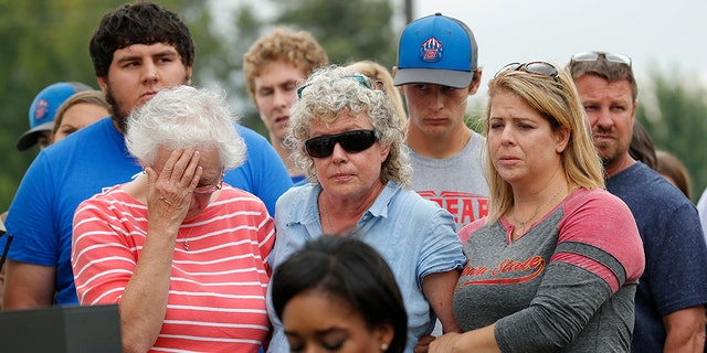 Mollie Tibbetts' mother, Laura Calderwood [center], listens at a news conference on Aug. 21, 2018, the day her daughter's body was found.