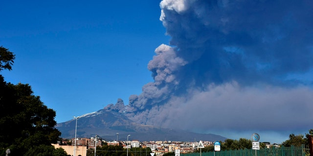 A smoke column comes out of the Etna volcano in Catania, Italy, Monday, Dec. 24, 2018.