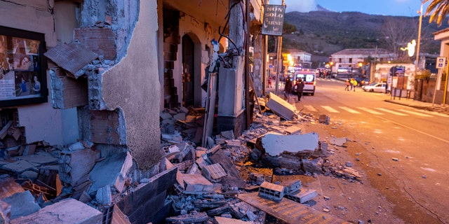 Debris of a partially collapsed house sit on the street in Fleri, Sicily Italy, Wednesday, Dec. 26, 2018.