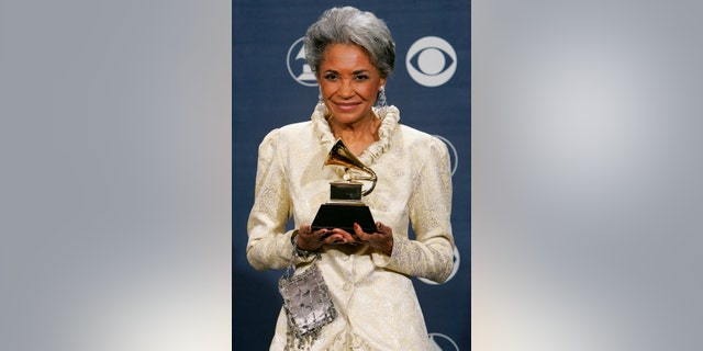 """FILE - In this Feb. 13, 2005 file photo, Nancy Wilson holds her Grammy award for best jazz vocal album for """"R.S.V.P. (Rare Songs, Very Personal)"""" at the 47th Annual Grammy Awards in Los Angeles. (Associated Press)"""