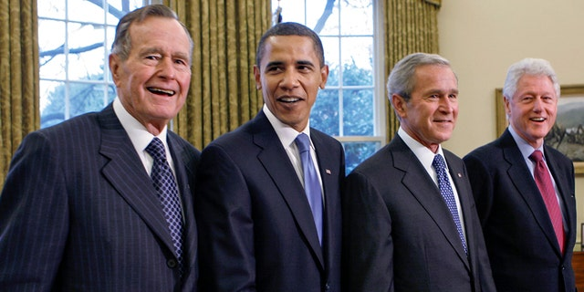 Former President George H.W. Bush, left, joins then President-elect Barack Obama, President George W. Bush, former President Bill Clinton and former President Jimmy Carter in the Oval Office in 2009. (AP Photo/J. Scott Applewhite, file)