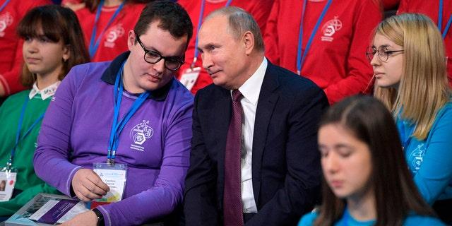 Russian President Vladimir Putin, center, attends a high-tech forum for youth in Yaroslavl, Russia, Thursday, Dec. 13, 2018.