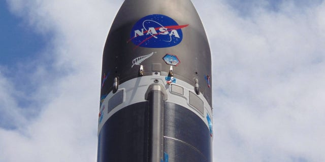 The NASA logo is emblazoned on a Rocket Lab Electron booster ahead of the company's first launch for the U.S. space agency on Dec. 12-13, 2018 from Mahia Peninsula of New Zealand's North Island.