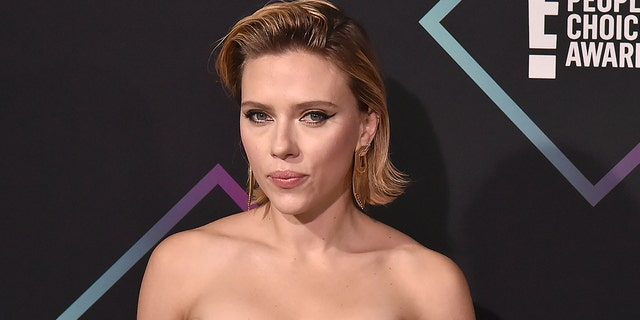 Scarlett Johansson said portraying country legend Dolly Parton in a biopic would be 'big shoes to fill,' but said she'd be interested 'for the costumes alone!'