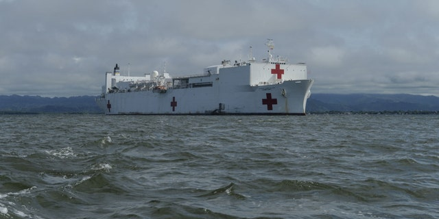 The hospital ship USNS Comfort (T-AH 20) is anchored off the coast of Colombia to offer medical treatment aboard the ship and at a land-based medical site.