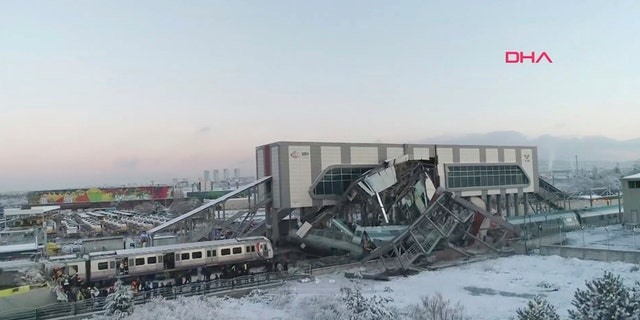 This image made from video shows aftermath of a high-speed train crash at a station in Ankara, Turkey, Thursday, Dec. 13, 2018. (DHA via AP)